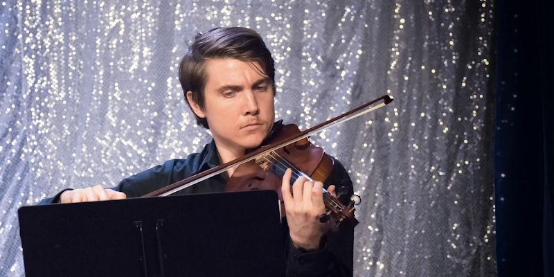 Young Man Playing Violin Concert at PAL